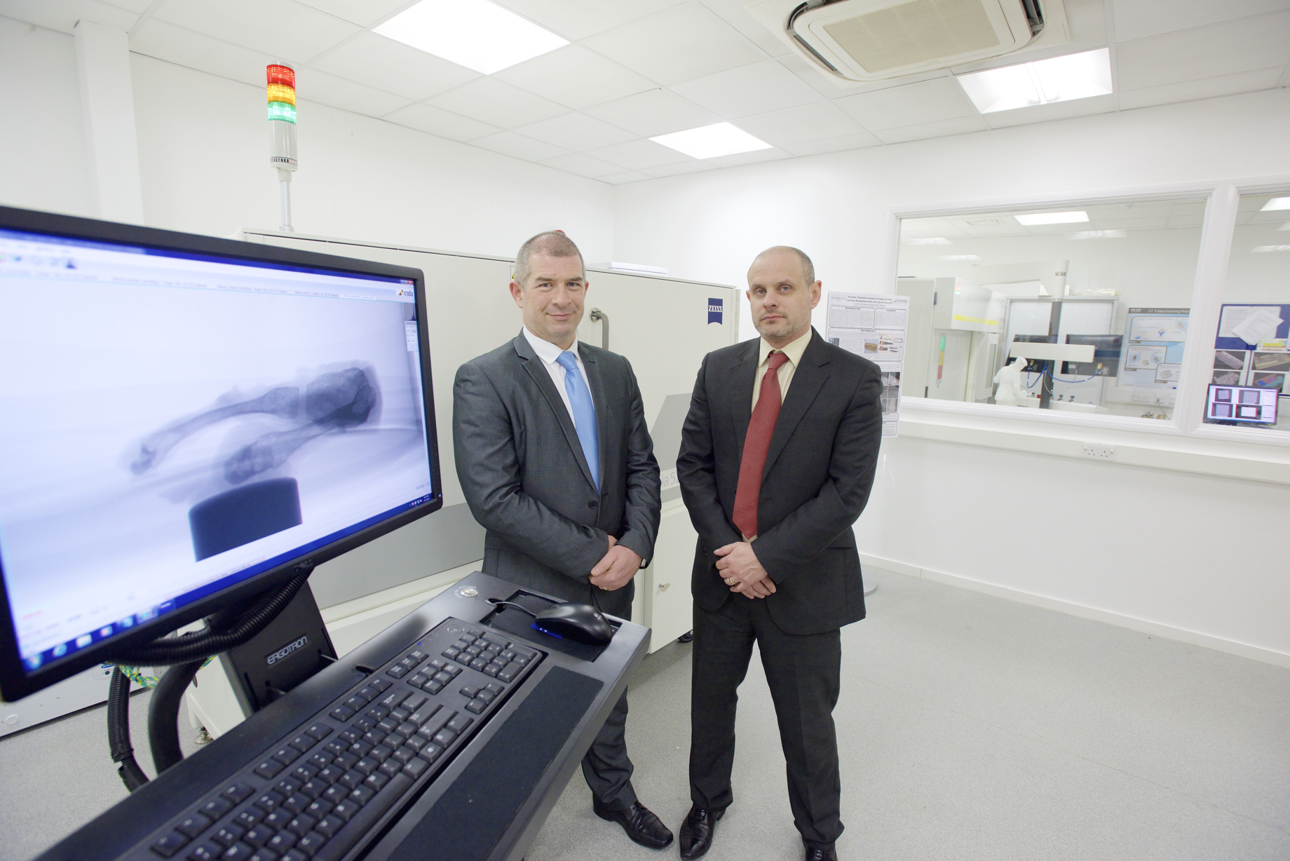 Detective Superintendent Mark Payne (left) and Professor Mark Williams (right) at WMG's metrology facility
