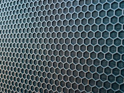 Speaker Grill Up Close Showing Repeating Hexagonal Pattern